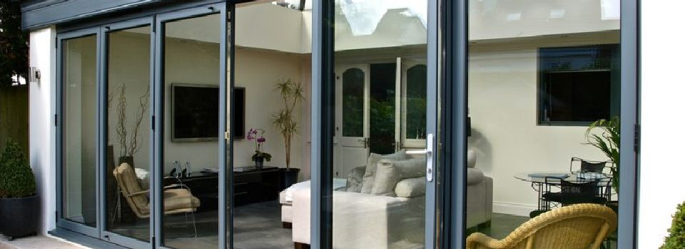 An image showing a 5 panel bifolding door installed by bifold by design in Beaconsfield.