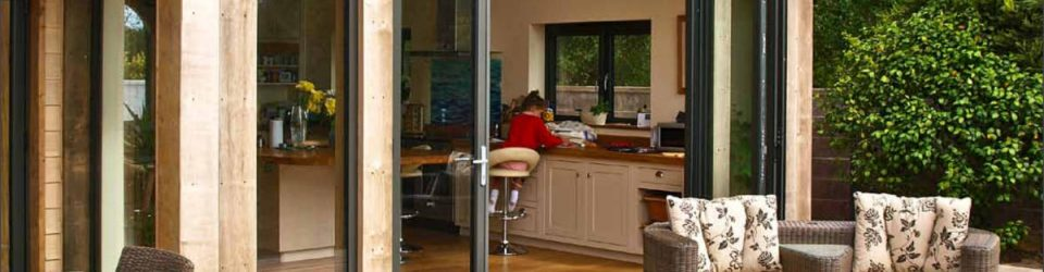 An image showing an open set of bifolding doors,installed in Northwood