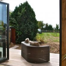 An image showing the view outside through bifolding doors in Northwood.